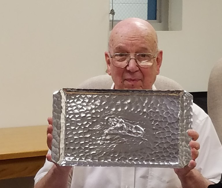 Dr. Lester Griel holding his gift for 53 years of service to Penn State